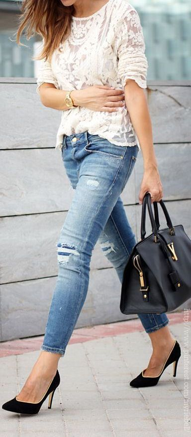 casual chic street style with worn denim jeans, black leather pumps and a lace blouse, large satchel / tote