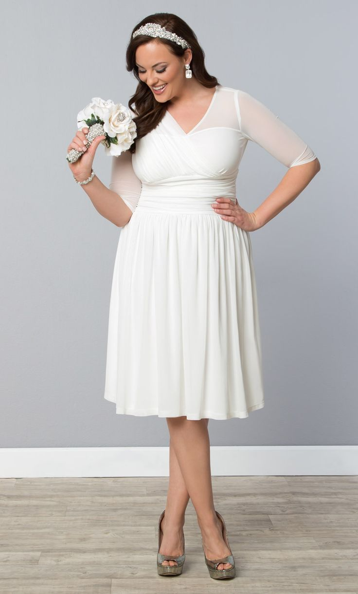 Want something unique, yet simple for your special day?  Our plus size Forever Yours Wedding Dress is perfect!  A soft mesh will keep you comfortable and cool, while a unique Grecian style bodice gives a stunning look for a beautiful bride.  Explore more made in the USA bridal gowns at www.kiyonna.com.  #PlusSizeFashion