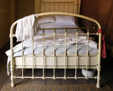 The second floor bedroom in the 1870s house in the Birmingham Back to Backs, with an iron bedstead and a chamber pot under the bed