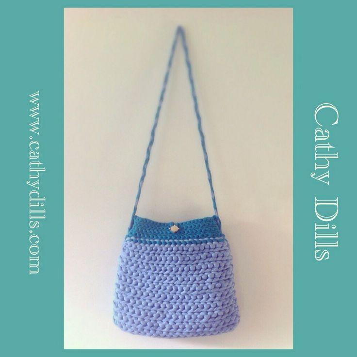 """Blue & turquoise green crochet handbag"" by Cathy Dills."