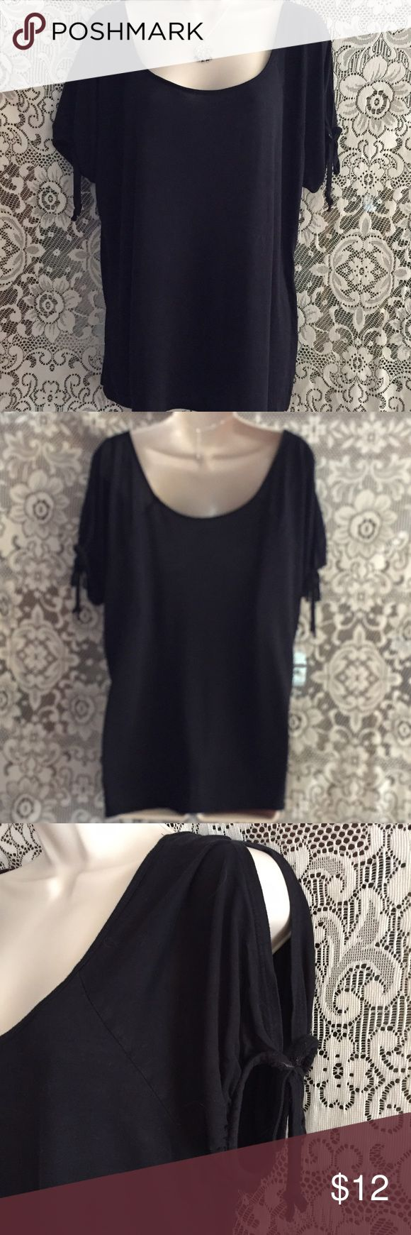 COLD SHOULDER SHORT SLEEVE TOP Love this top but doesn't fit anymore. A.N.A. Black short sleeve, cold shoulder soft top with ties on the sleeves. Deep scoop neck in front and back. Looks amazing on! Gently used! a.n.a Tops