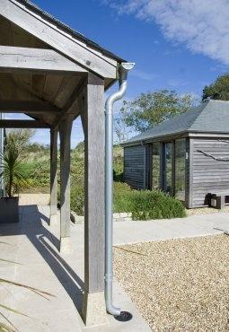 Oak porch with cedar-clad outbuilding behind