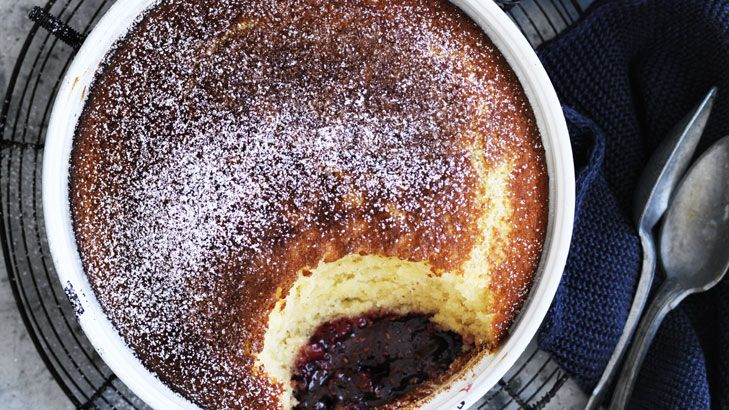 Neil Perry's coconut pudding has a delicious surprise at the bottom. You can use jam instead of fresh berries in winter.