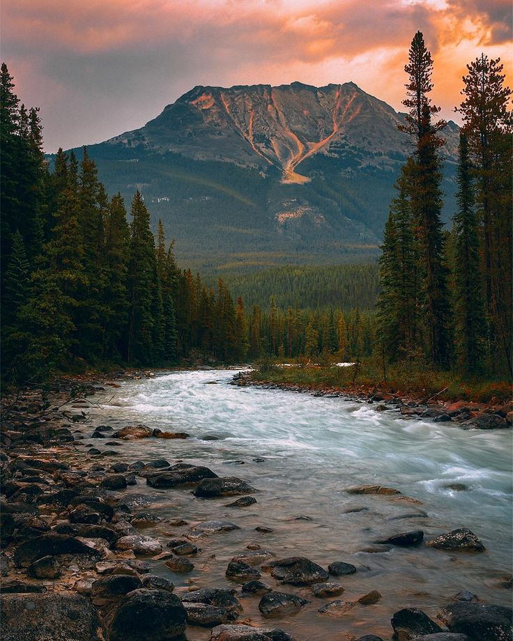 Upstream from Sunwapta Falls (Jasper National Park, Alberta). The smoke from the BC fires create orange colour. by RÉJEAN BRANDT (@rejbrandt) on Instagram