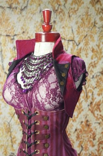 Crazy Purple Striped Torian Corset with Steampunk Accents and Sheer Purple Lace Blouse and Purple and Black Cropped Vest by Damsel in this Dress