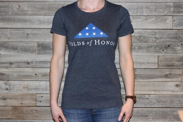 Our classic T-Shirt is a Next Level Apparel 60% cotton, 40% polyester blend. It features the Folds of Honor logo on the chest, American Flag on sleeve, and Folds of Honor logo on the nape of the neck.