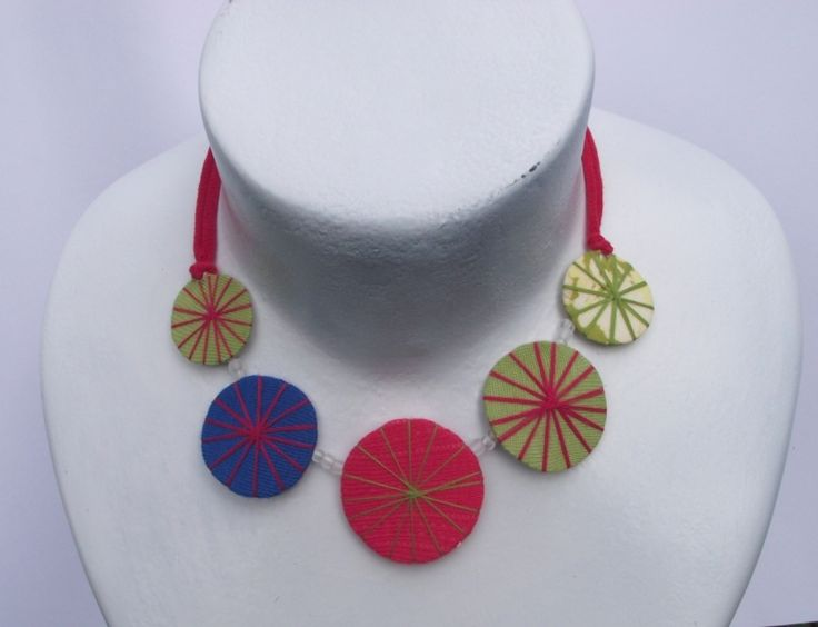 http://annmack.co.za/store/products/category/jewellrey-handmade/ Recycled necklace made from waste fabric and string