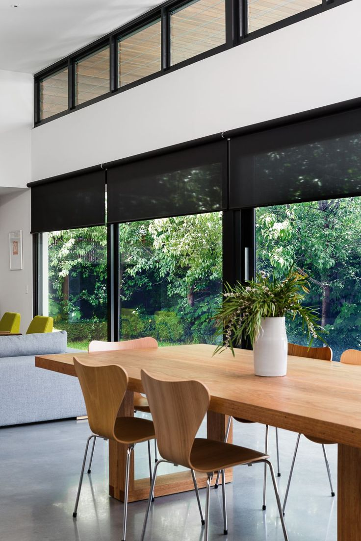 Full wall screen fabric roller blinds in kitchen and living space.