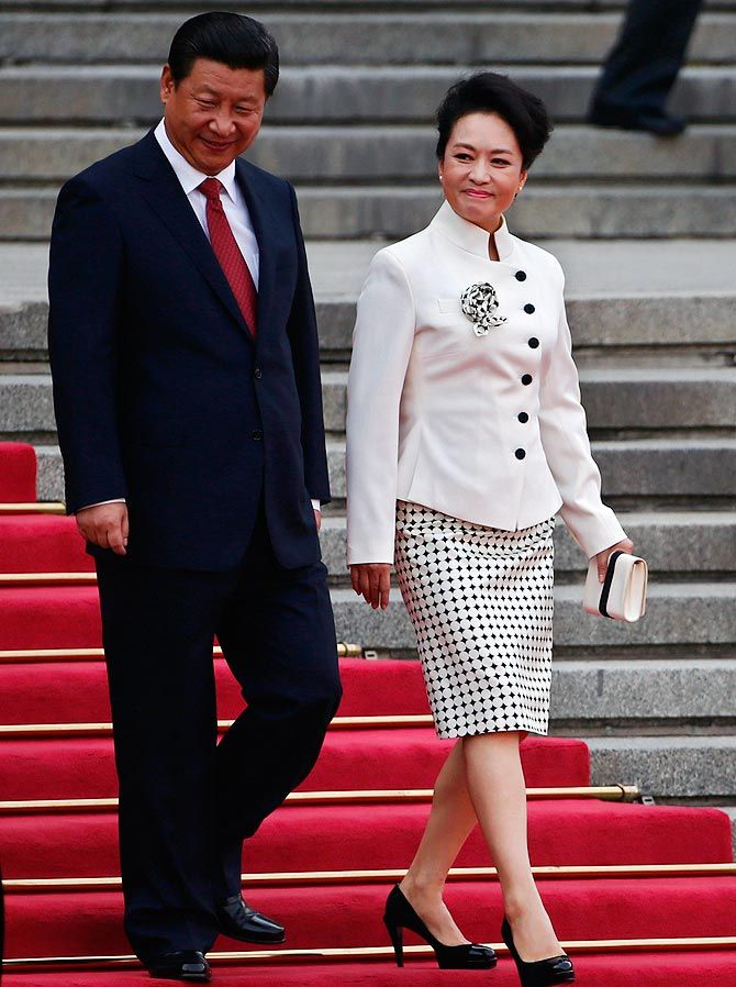 Chinese President Xi Jinping (L) and his wife Peng Liyuan seen outside the Great Hall of the People in Beijing.