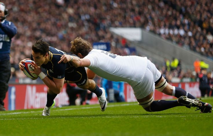 Sean Maitland of Scotland goes over to score the opening try tackled by Geoff Parling of England during the RBS Six Nations match between England and Scotland at Twickenham Stadium on February 2, 2013 in London, England.