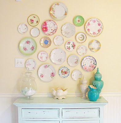 Plates are the perfect cottage style decorating accent. I love the way this color scheme is played out, even with the painted dresser below the eclectic plate collection.