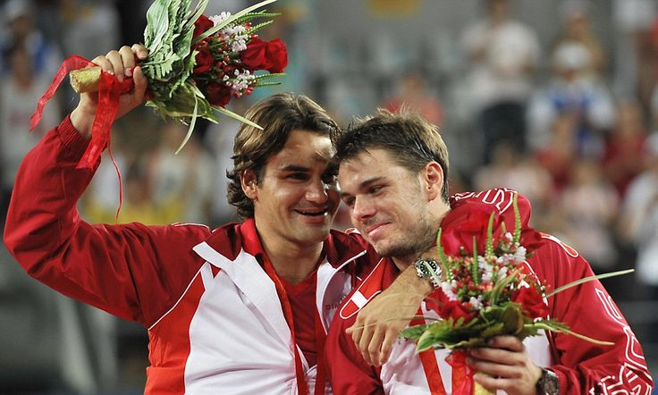 Best buds Roger Federer and Stan Wawrinka celebrate their gold medal in doubles at the 2008 Beijing Olympics