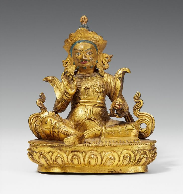 A Sinotibetan gilt bronze figure of Vaishravana. 18th century A Sinotibetan gilt bronze figure of Vaishravana, seated on a lotus base, his right hand in vitarka mudra, his left holding a jewel-spewing mongoose, dressed in armour, boots and a sash. The face cold gilt and polychrome. Base resealed. 18th century. Height 17.8 cm