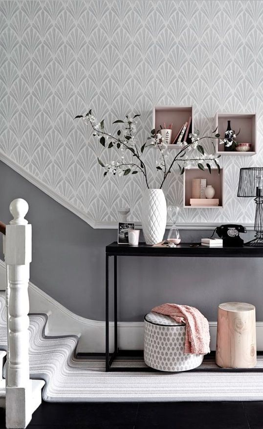 Team a patterned wallpaper in a soft shade with a darker toning paint colour for a hallway with impact. Box shelving is an easy and stylish storage solution. Photography: Mark Scott