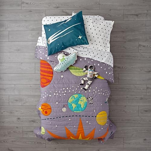 An outer space bedroom is the perfect choice for boys who love planets, rockets, galaxies and all things related to outer space. There are many options available to assist in creating an outer space theme room. As this is a very popular theme for young boys, there is a very unique selection of comforters and quilts