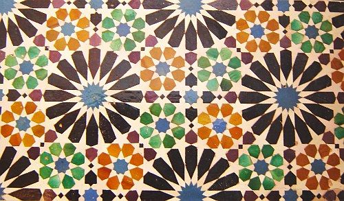 Beautiful tile pattern. One of many found adorning the Alhambra in Spain. The tile patterns found there feature 13 of the 17 wallpaper groups.