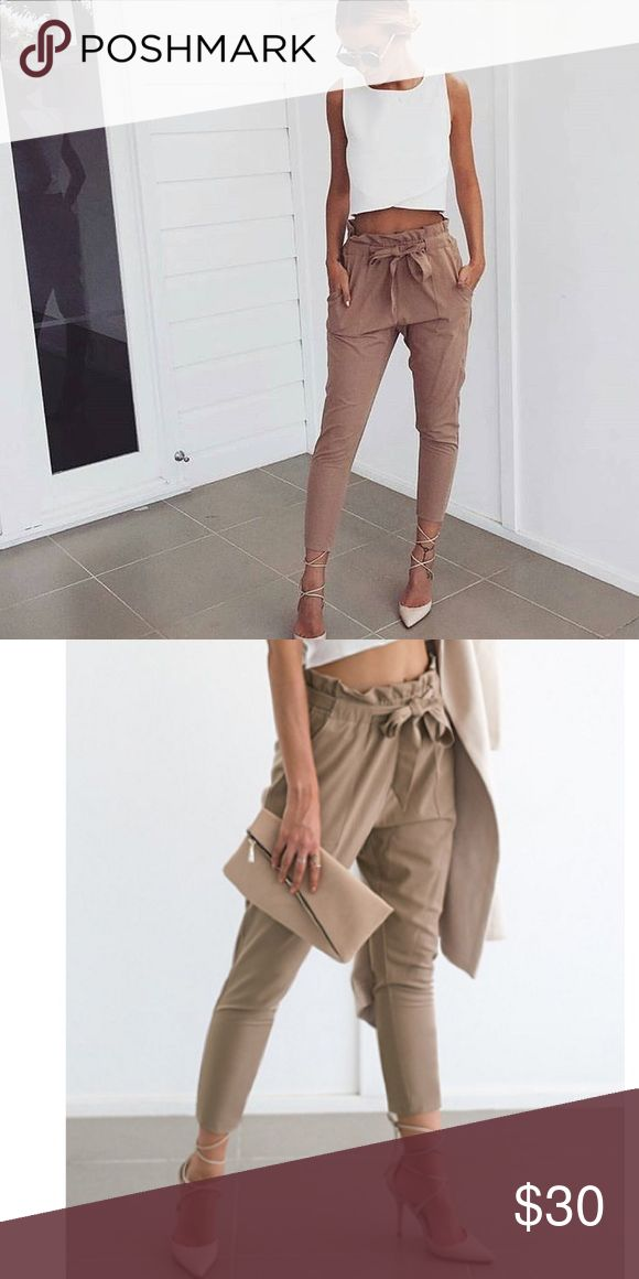 NWT Beige Trousers Stylish and chic women's beige trousers. Cinched waist and belt included. Brand new in the original package. Pants Trousers