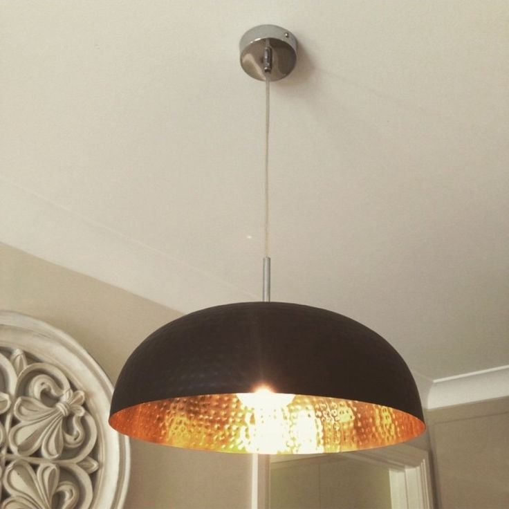 is a genius with this one! These are the black and copper large bowls from Kmart hacked into pendant lights for about a quarter of the price! Winning!!