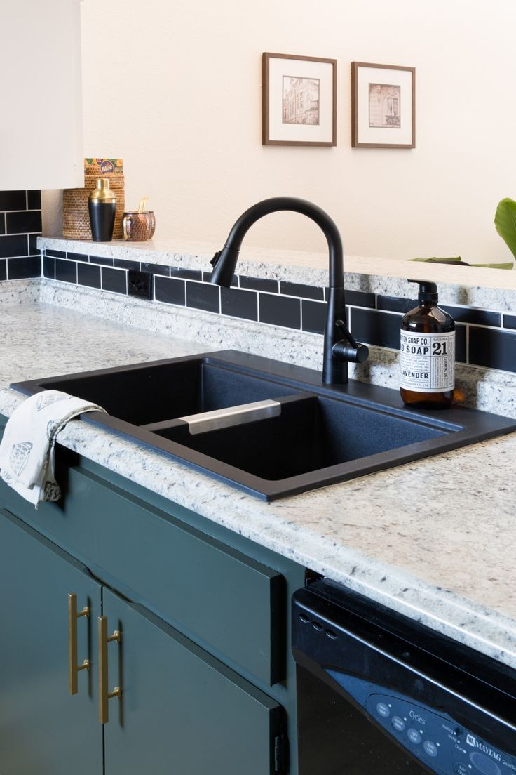 Laminate gets a bad rap but it has come a LONG way. New laminate countertops are budget-friendly, easy to install, durable, and look high-end. The contrast with this black matte sink is next level kitchen style.