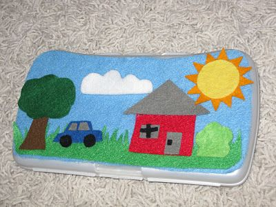 Turn a wipes case into felt board -- glue felt to the back and store the picture pieces inside.