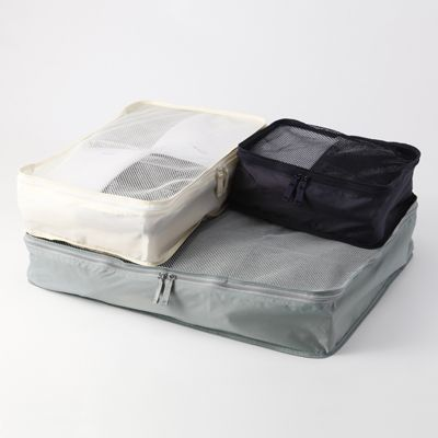 Fordable mesh garment bags, Muji  Very light, visible and fits in very well in your suitcase or travel bag. I already have 3 of them in different sizes.