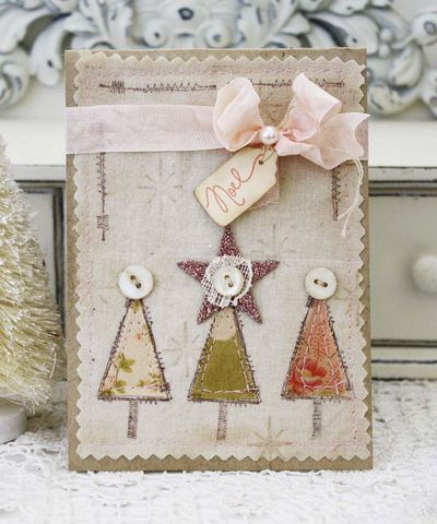 Beautiful Christmas card created by Melissa Phillips. Stamping onto fabric, stitching, buttons, ribbon and tag