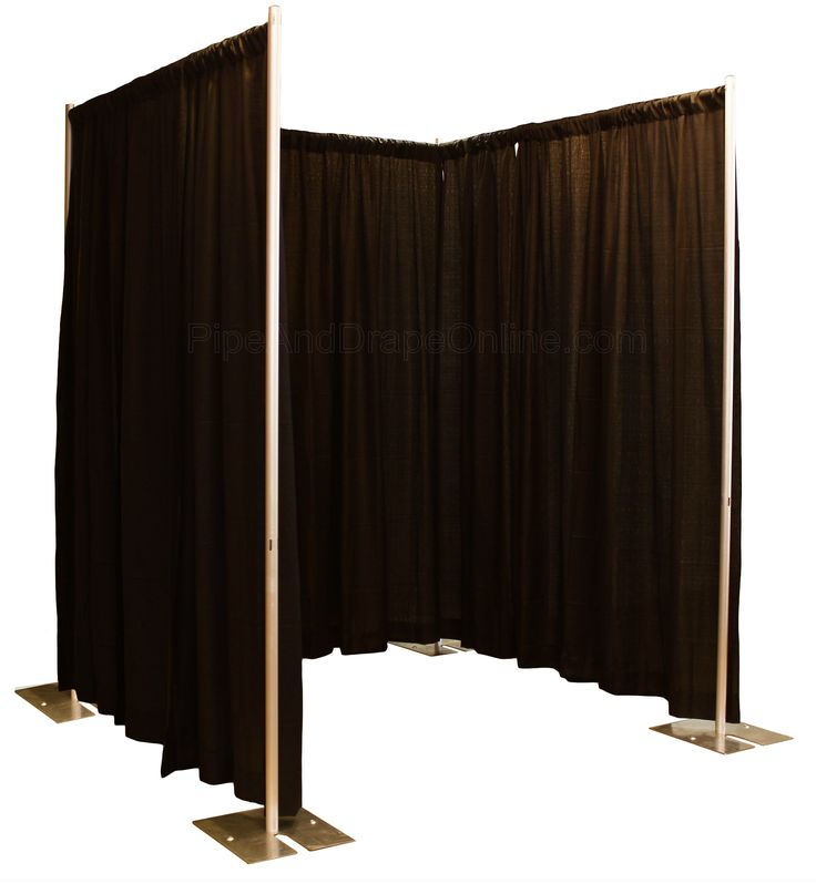 A pipe and drape photo booth enclosure