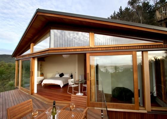 This luxury eco B lodge in Omapere in the Hokianga is well worth the longer drive. It was architecturally designed and was inspired by a leaf lying gently on the ground;  harmonious in its environment. http://www.bookabach.co.nz/20310