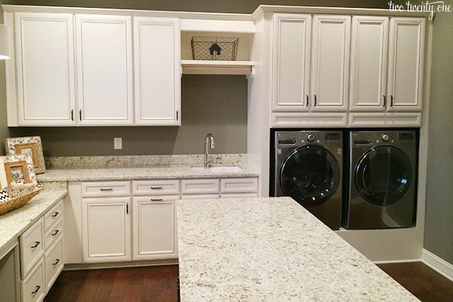laundry room with tons of storage, an island for folding clothes, and a gift wrapping station!