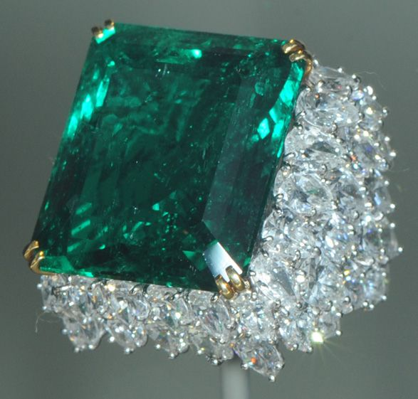 This is the Chalk Emerald, a 37.8 carat emerald from Columbia. Columbia is the major source of emeralds. It is nestled in a cluster of 60 pear-shaped diamonds weighing a total of 15 carats. It is housed at the Smithsonian Institute.