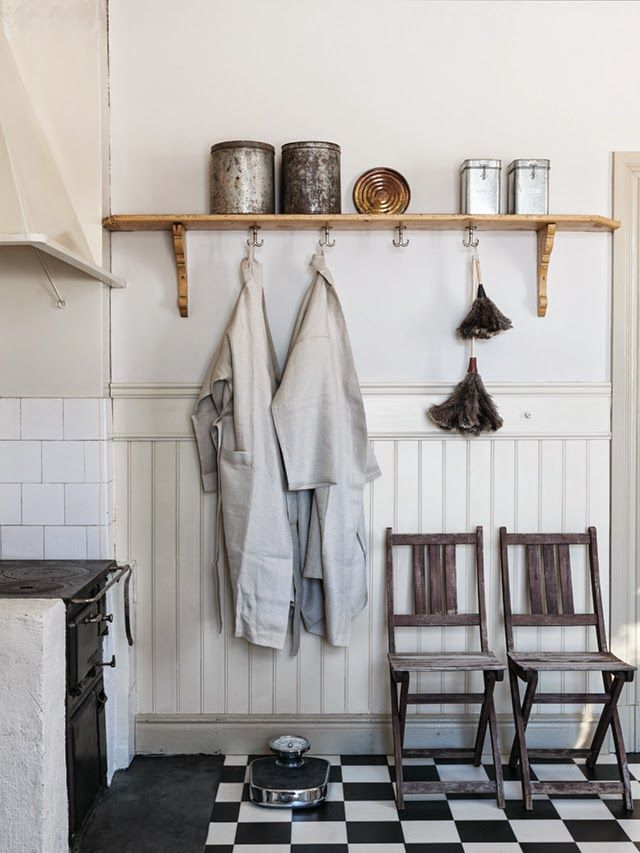 rusty metal tins and clothing hooks