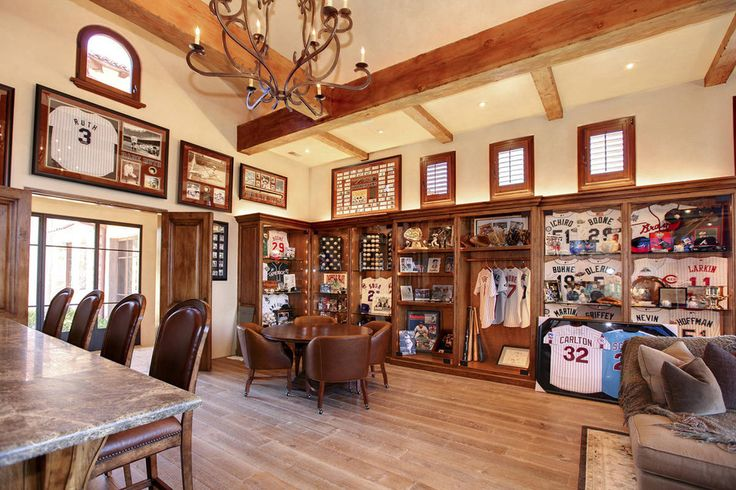 Built-in display cases for Mr. Boone's sports memorabilia. A third-generation major leaguer, Mr. Boone played second base for several teams during his career, including the Seattle Mariners and the Cincinnati Reds.