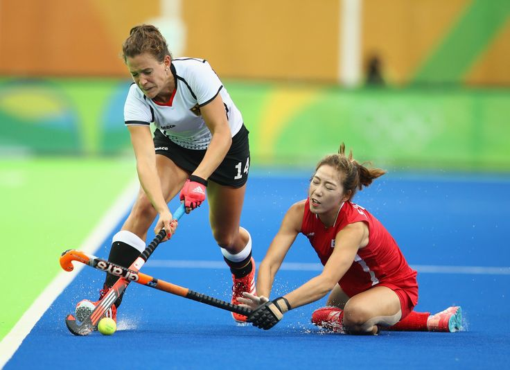 Janne Muller-Wieland of Germany is challenged by Jungeun Seo of Korea during the Women's Pool B Match between Germany and Korea on Day 5 of the Rio 2016 Olympic Games at the Olympic Hockey Centre on August 10, 2016 in Rio de Janeiro, Brazil.
