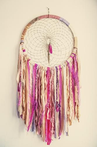 Non-traditional dream catcher.  Could be nice decor, but i'm still making a real one for my baby babies