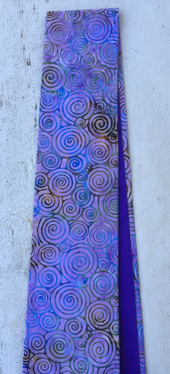 This Clergy stole would be perfect for lent! A wonderful spiral design with shades of purple, it is also lined in a purple cotton and can be worn reversed. It would a great gift. The width at the neck is 3 1/2 inches and 4 1/2 inches at the end. It can be reversed for a solid purple