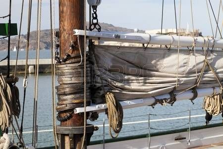 hawser: The hawser on the sailboat mast and the square sail
