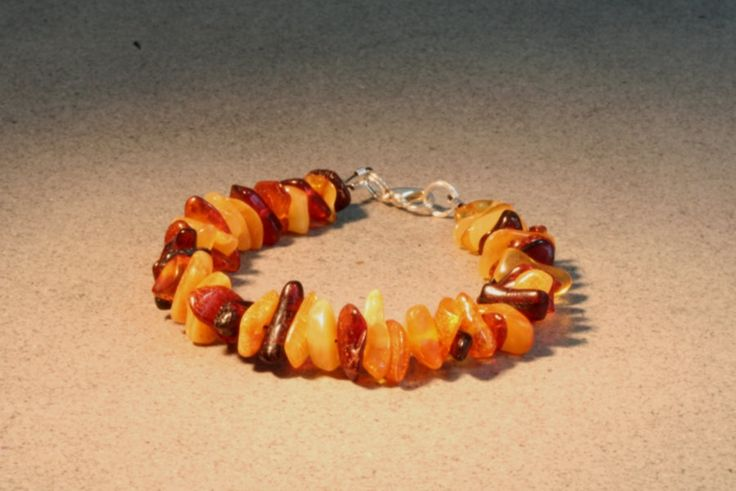 This is a natural 19 cm (7.5 inch) long handmade multicolor amber bracelet of selected multi-colored Baltic amber beads, suitable for both him or her.