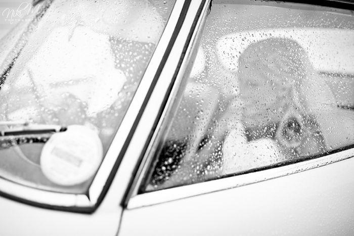Rainy wedding with vintage car Niki M Photography