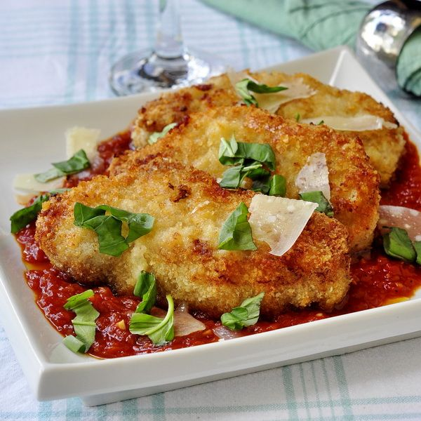 No frying needed for these Crispy Parmesan Panko Pork Chops  - one of our family's favorite meals. These juicy baked chops are delicious with pasta and a simple Mariana sauce.