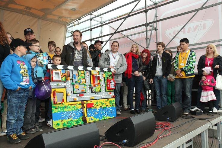 Big LEGO clappeboard made by kids for festival.
