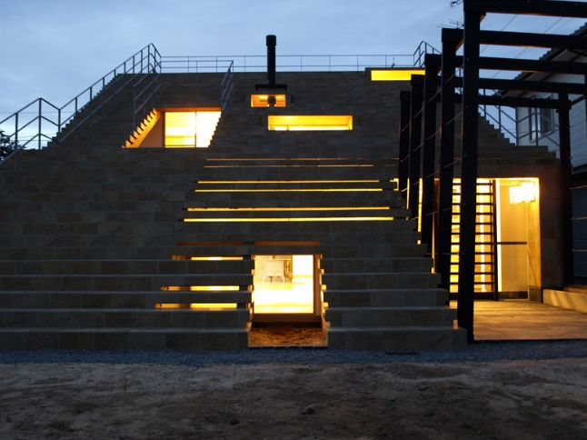 Stairs House / an interesting residential home from y+m design office. Located in Shimane Prefecture, Japan, the exterior of the house forms a giant set of stairs.