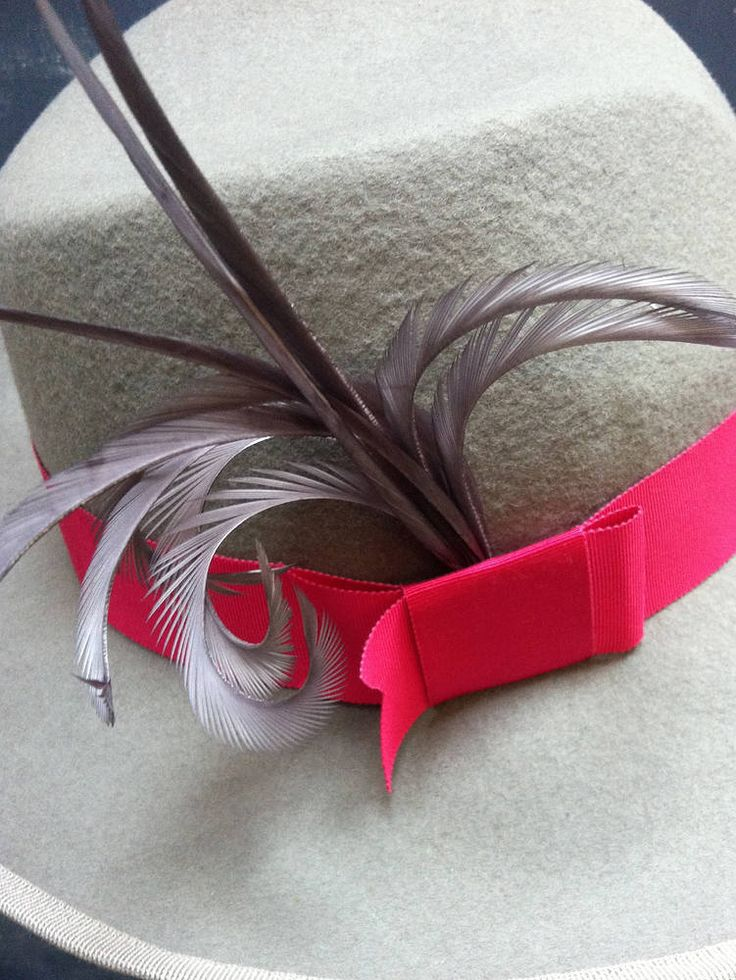 Love this colour combination.... Taupe fedora with hot pink trim and grey feathers.