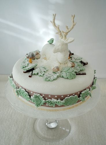 Stunningly beautiful, whimsical, enchantingly lovely Stag and Leaf Cake. cake. Have an outdoorsman in your life, but you like elegant? Try this out! Get a stag ornament/sculpture (make sure it's lightweight) and then use store-bought icing leaves (which you can dust with powdered sugar for a snow look, if desired), cinnamon sticks (for branches), and sugared berries or acorns. More