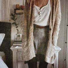 Layers | Long oatmeal cardigan, mini skirt, ribbed tank top, black tights