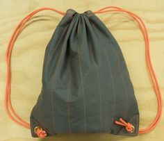 Sew a Durable DrawstringBag. Would be a good cheap backpack to donate to homeless or other shelters. Durable and compactable.