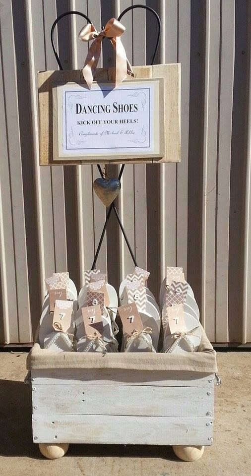 Pallet box and sign to hold thongs which will be used at a wedding
