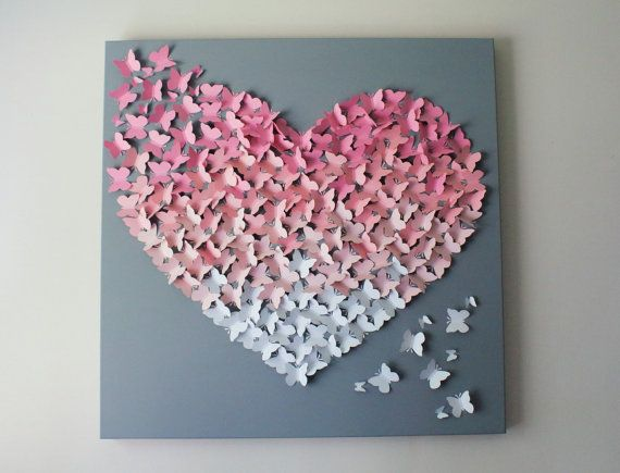 3D Pink Ombre Butterfly Wall Art in soft pinks and soft grey. Chose your size! Chose 30 x 30, 24 x 24 or 20 x 20.  Painted soft grey gallery wrapped artists canvas with hundreds of individually attached soft pinks and white butterflies in an ombre design. Butterflies measure approximately 2 in size and come together to form a 3D ombre heart. Makes a beautiful statement piece in any room. Perfect for any space in your home including nurseries, childrens rooms or make a beautiful statement…