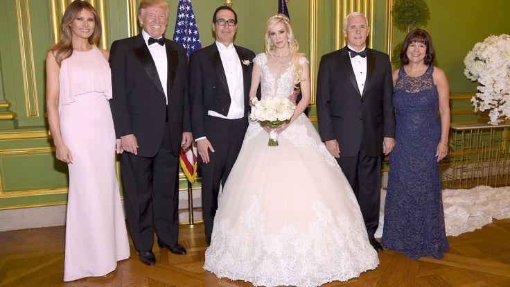 WASHINGTON, DC - JUNE 24: (Exclusive Coverage) (L-R) First Lady Melania Trump, President Donald Trump, Secretary of the Treasury Steven Mnuchin, Louise Linton, Vice President Mike Pence, and Second Lady Karen Pence pose at the wedding of Secretary of the Treasury Steven Mnuchin and Louise Linton on June 24, 2017 at Andrew Mellon Auditorium in Washington, DC. Louise Linton is wearing a custom Ines Di Santo gown with wedding ring and earrings by Martin Katz.  (Photo by Kevin Mazur/Getty Images…