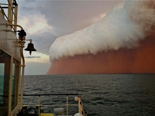A towering red dust storm goes over the ocean ahead of a cyclone approaching Onslow on the West Australian coast, on Jan. 9. Tug boat worker Brett Martin, who captured the fearsome pictures 25 nautical miles from the town of Onslow, reported conditions were glassy and flat before the storm hit late on January 9. But when the wild weather arrived, the swell lifted to 6 feet, winds increased to 40 knots and visibility was reduced to 328 feet.