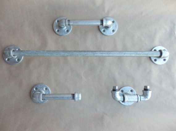 4 Piece Galvanized Pipe Bathroom Set for an Industrial Style Bathroom. Includes Towel Rack, Towel Hook, Hand Towel and Toilet Paper Holder